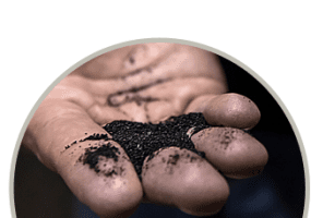 Photo of hand holding black carbon